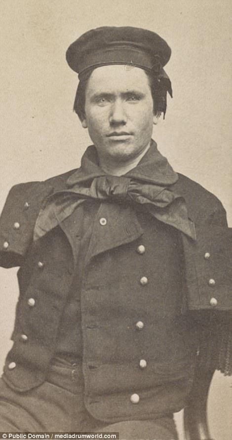 Richard D. Dunphy, formerly Coal Heaver of US Navy in suit, had to undergo a double amputation to both of his arms
