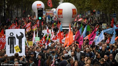 People in Paris take part in a nationwide strikes and demonstrations day called by nine unions representing 5,4 million public sector workers