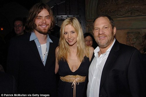 Mighty Harvey:Mira Sorvino says that Weinstein made sexual advances towards her back in 1995 in a hotel room and later by showing up to her apartment unannounced (Sorvino and her husband Chris Backus with Weinstein in 2006)