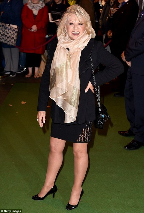 Here come the girls: Theatre star Elaine Paige flashed her leggy figure in a saucy mini skirt