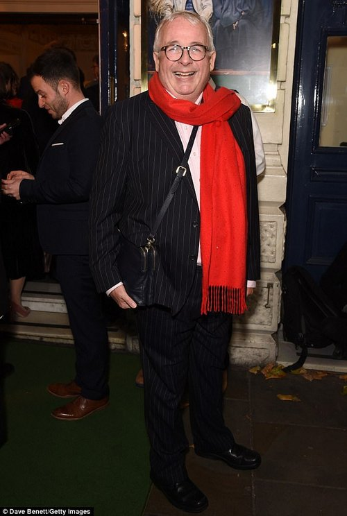 Say cheese! Christopher Biggins beamed widely for cameras as he headed inside to watch the show in a pinstriped suit