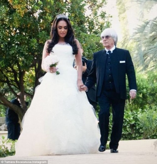 Blushing bride: Tamara Ecclestone has lashed out at cruel trolls who claimed she looked like a 'giant' on her wedding day next to her 'dwarf' father Bernie Ecclestone