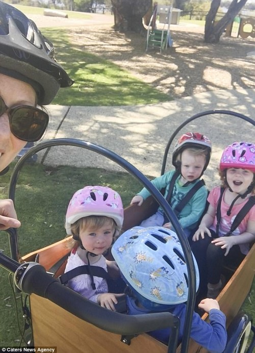 'I have a cargo bike that I strap the kids into and I use it to take them to school, to the market and to the library,' Taryn said (pictured taking Ava, Euan, Posey and Bryn out for a bike ride)