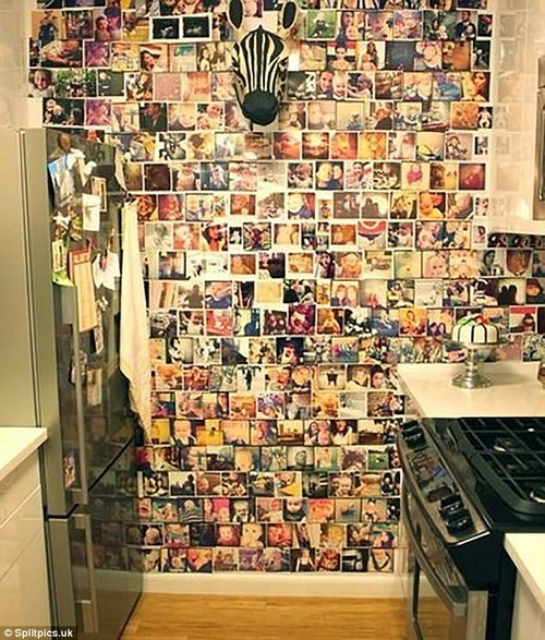 How long did that take? This homeowner took the 'feature wall' concept to the next level by adorning their kitchen with hundreds of baby photos