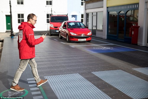 Step 2: Once the progress bar turns green, so does the spot you are stood on. A zebra crossing then shines through the road directing you to head across. There are also new markings on the road from cars and vans telling them where they need to stop and a blue section for any approaching cyclists to stop in ahead of the other vehicles
