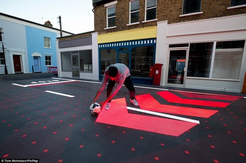 The system can detect when something unusual is happening, such as a child chasing a football into the road. The red chevrons suggest to road users where the child may enter the road and 'STOP' markings appear before them to stop oncoming cars and vans