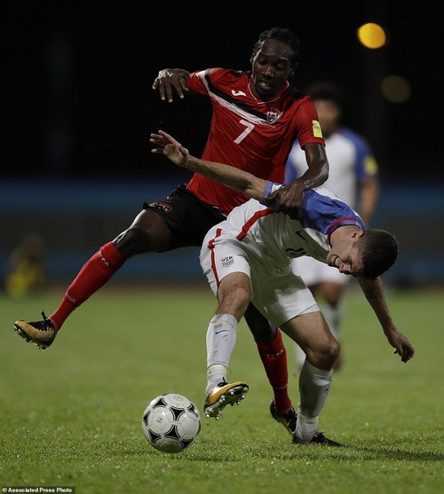 United States' Christian Pulisic, front, fights for control of the ball with Trinidad and Tobago's Nathan Lewis Oct. 10, 2017