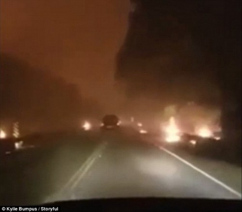 The brake lights of a vehicle in front of them are barely visible at some points as the smoke becomes too thick