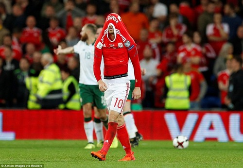 Aaron Ramsey pulls his shirt over his head as another World Cup dream falls by the wayside for a further four years