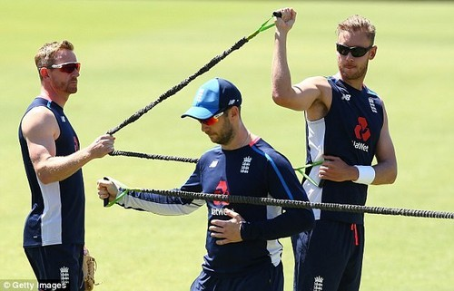 Bowler Stuart Broad (right) is helped by coach Paul Collingwood as he warms up