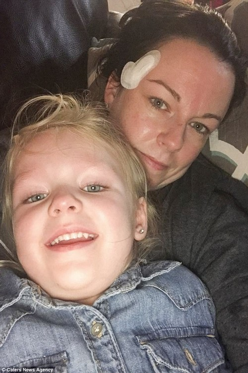 Ms Jones (pictured with her daughter) required 20 stitches and three surgeries on the wound