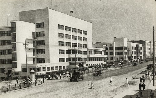 Main street in Kharbarovsk, 1937: House of Soviets by I. Golosov and B. Ulinich (foreground) and a bank by V. Vladimirov (background).