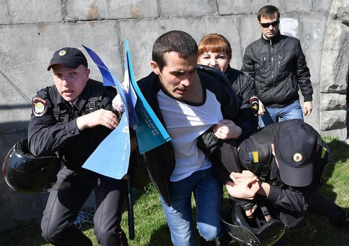 Police officers detain a protester at an anti-Putin rally in the Urals city of Yekaterinburg.