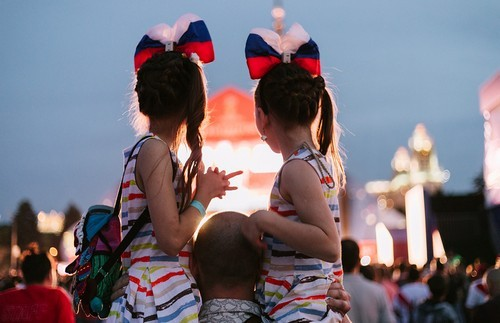 Two young girls are dressed in matching outfits to support Russia.