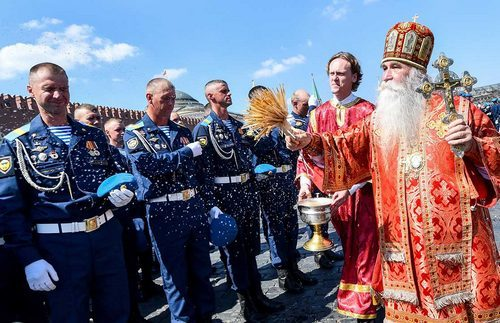 The troops receive a blessing from an Orthodox bishop.