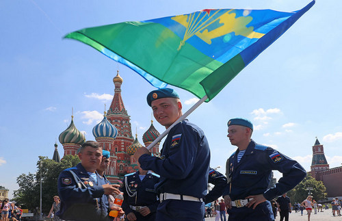 Red Square gets a spot of new color with the blue-green-and-yellow paratroopers' flag.
