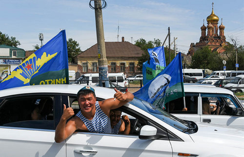Astrakhan's paratroopers drive out in iconic striped shirts called telnyashki.