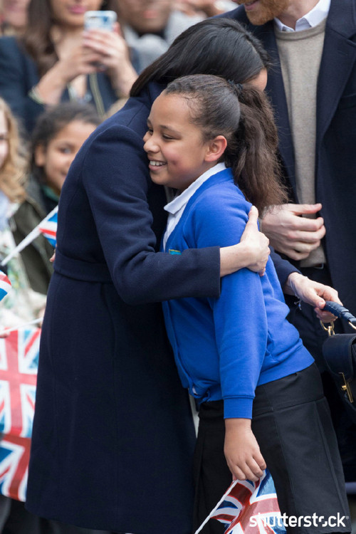Prince Harry and Meghan Markle: The Year in Review - Meghan Hugging a Girl