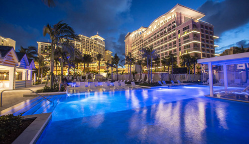 The pink SLS Baha Mar hotel at night, with Grand Hyatt in the background.