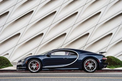 One of the most powerful production vehicles ever produced, the Chiron upholds Bugatti's reputation as an uncompromising crafter of vehicles featuring both supreme performance and refined design cues, building upon the success of the Veyron series.