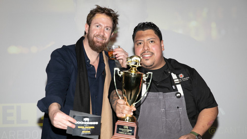 """Chef Daniel Espinoza of Cantina Laredo pictured holding the trophy alongside founder Brady Lowe. Espinoz clinched the """"Prince of Pork"""" title and will represent Chicago at Grand Cochon, the national finale, on September 15 in Chicago."""