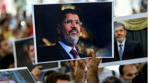 How did Egyptian newspapers report Mohamed Morsi's death?