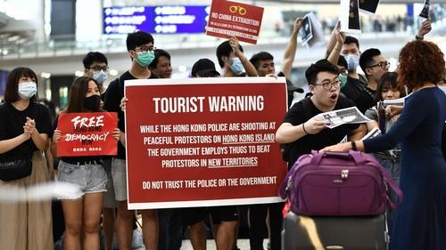 Flight attendants, airport staff join Hong Kong airport protest
