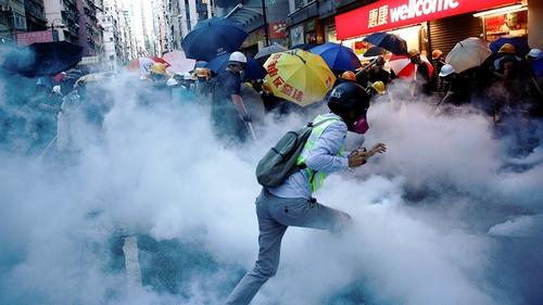 Hong Kong police fire tear gas as crowds target Beijing's office