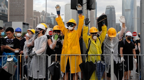 Hong Kong police use pepper spray, batons to disperse protesters