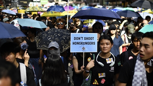 Protesters march against a controversial extradition bill in Hong Kong on July 21, 2019. - Another huge anti-government march kicked off in Hong Kong on July 21 afternoon with seemingly no end in sigh