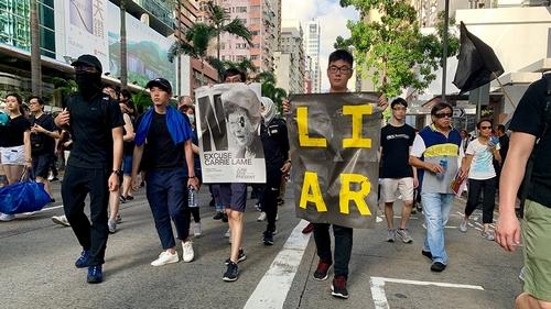 Mayhem in Hong Kong as police fire tear gas, rubber bullets