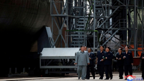 North Korean leader inspects new submarine as talks with US stall