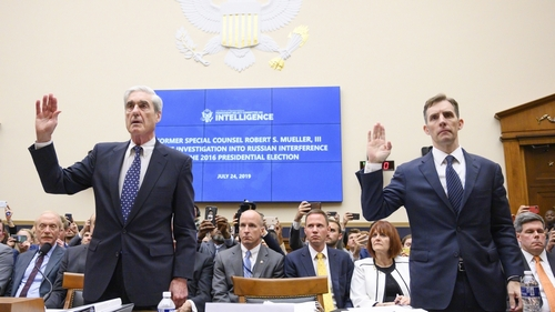 Former Special Counsel Robert Mueller (L) and former Deputy Special Counsel Aaron Zebley are sworn in for testimony before the House Select Committee on Intelligence hearing on Capitol Hill in Washing