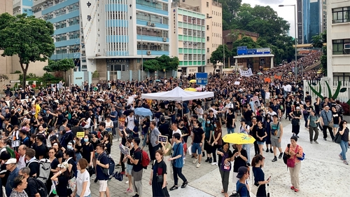 Thousands march in Hong Kong to draw mainland Chinese attention