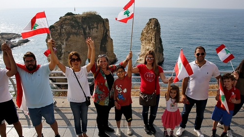 Lebanon protesters form human string across the country
