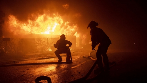 Raging Los Angeles wildfire destroys homes, prompts evacuations