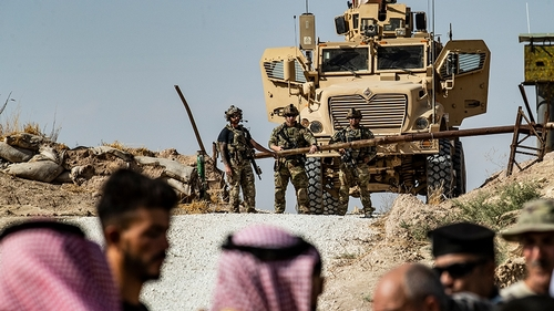 Syrian Kurds take part in a demonstration against Turkish threats at a US-led international coalition base on the outskirts of Ras al-Ain town in Syria's Hasakeh province near the Turkish border on Oc