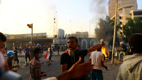 Health problems violence grips Iraq in view that security forces clear protest sites